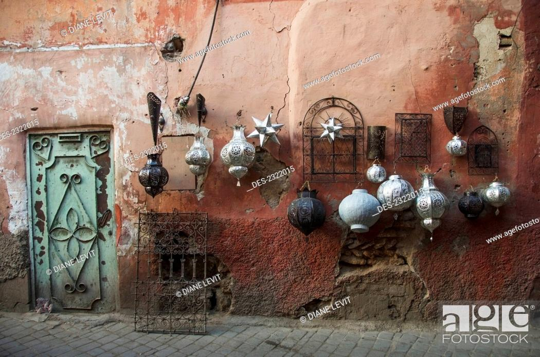 Stock Photo: Morocco, Marrakech, Decorative Baubles And Metal Wall Art On Display On Old Wall; Medina.