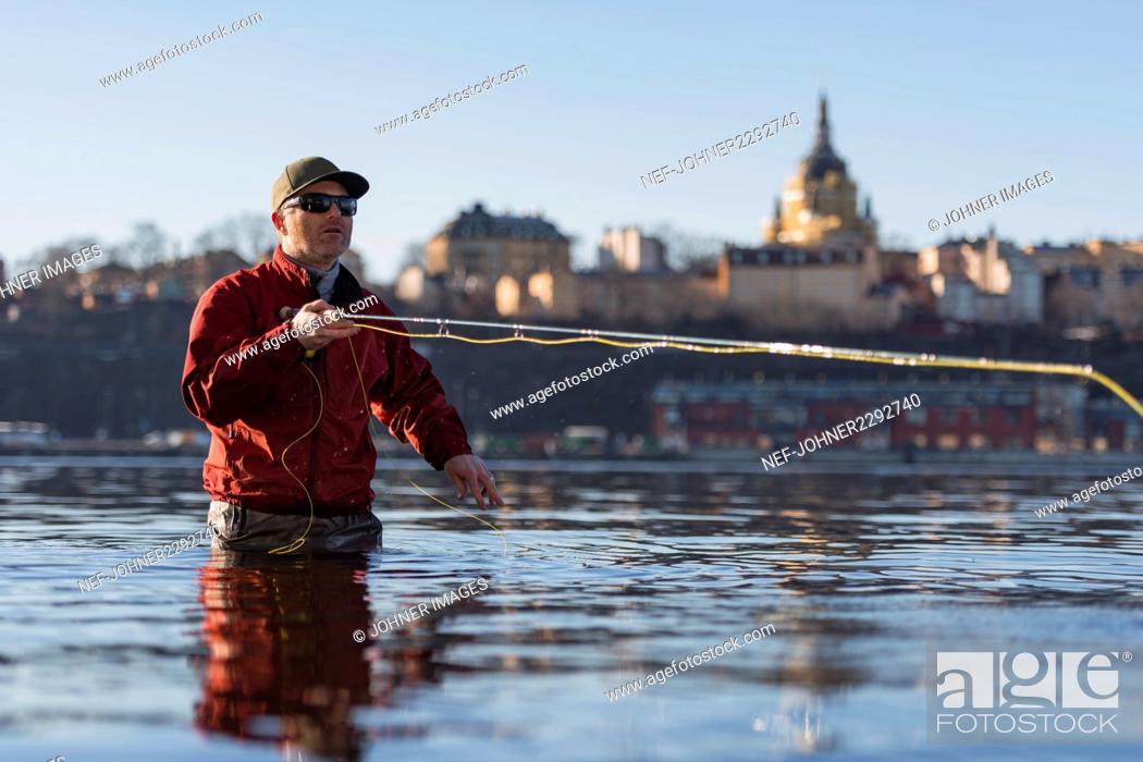 Stock Photo: Man fishing.