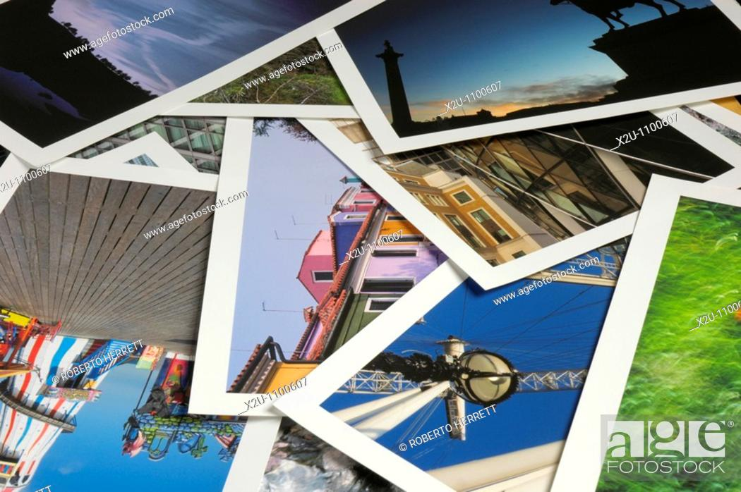 Stock Photo: Close-up of numerous overlapping colourful A4 photographic prints with white borders.