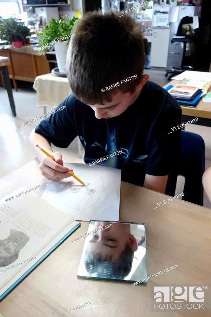 Stock Photo: 6th Grade Boy Drawing Self-Portrait With Mirror, Wellsville, New York.