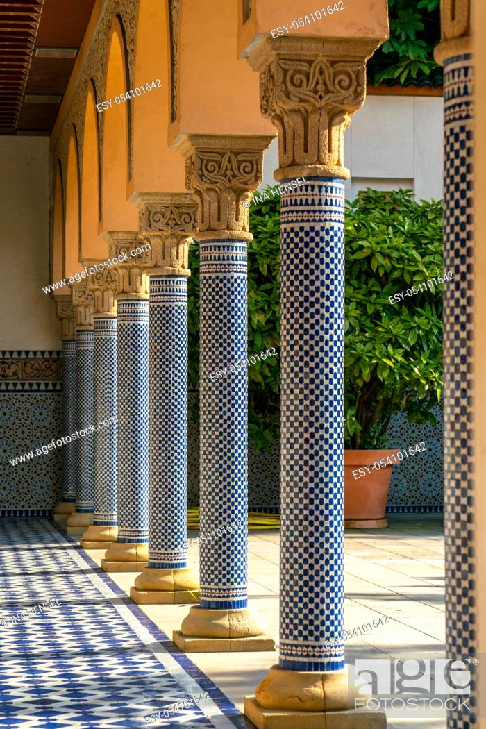 Stock Photo: Oriental looking columns with blue mosaic pattern and a tiled floor with oriental patterns.