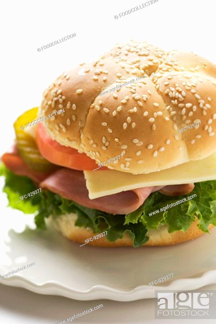 Stock Photo: Ham, cheese, tomato and gherkin in sesame roll.