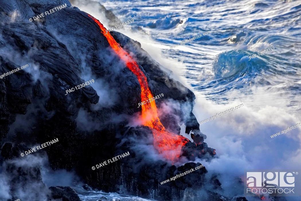 Stock Photo: The Pahoehoe lava flowing from Kilauea has reached the Pacific ocean near Kalapana; Island of Hawaii, Hawaii, United States of America.