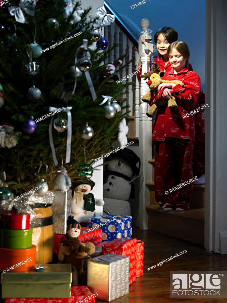Stock Photo: Children looking at presents on christmas eve.