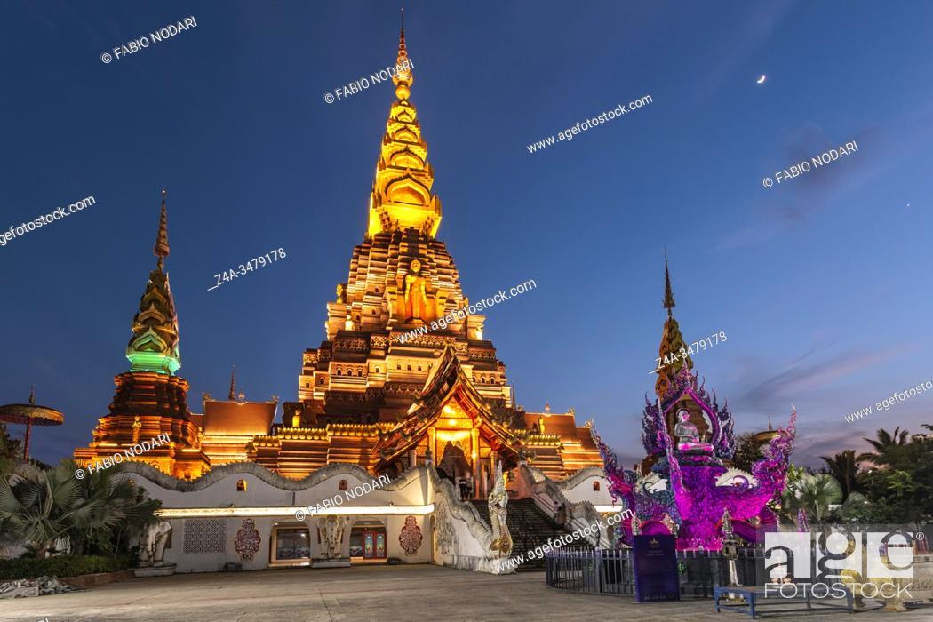 Stock Photo: Jinghong, China - December 30, 2019: Big Golden Pagoda in Jinghong, Xishuangbanna, at dusk also called Dajin Pagoda.