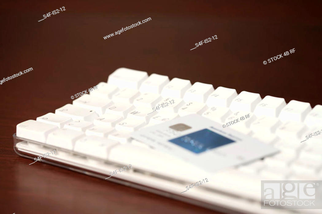 Stock Photo: Credit card on a keypad (part of), close-up.