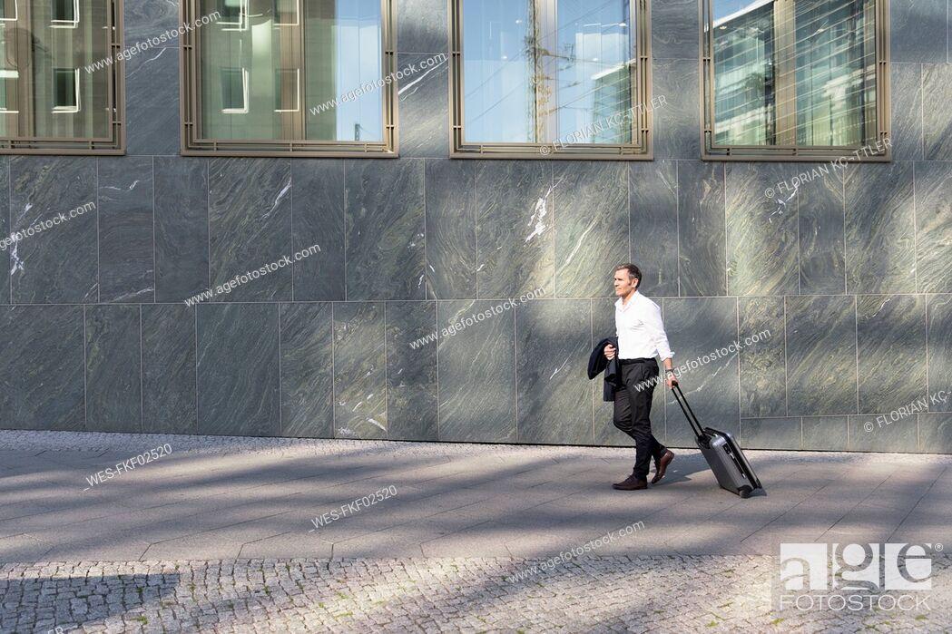Stock Photo: Mature businessman on a trip.