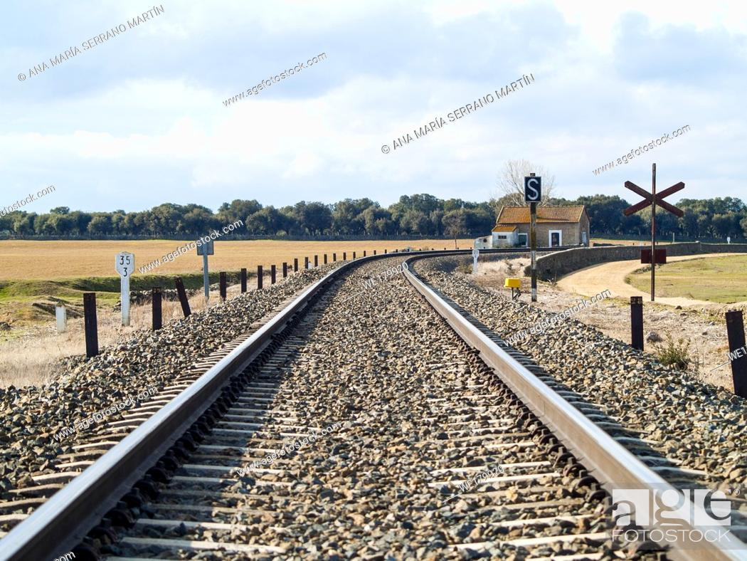 Stock Photo: Rural landscape of a railway track and a small railway station.