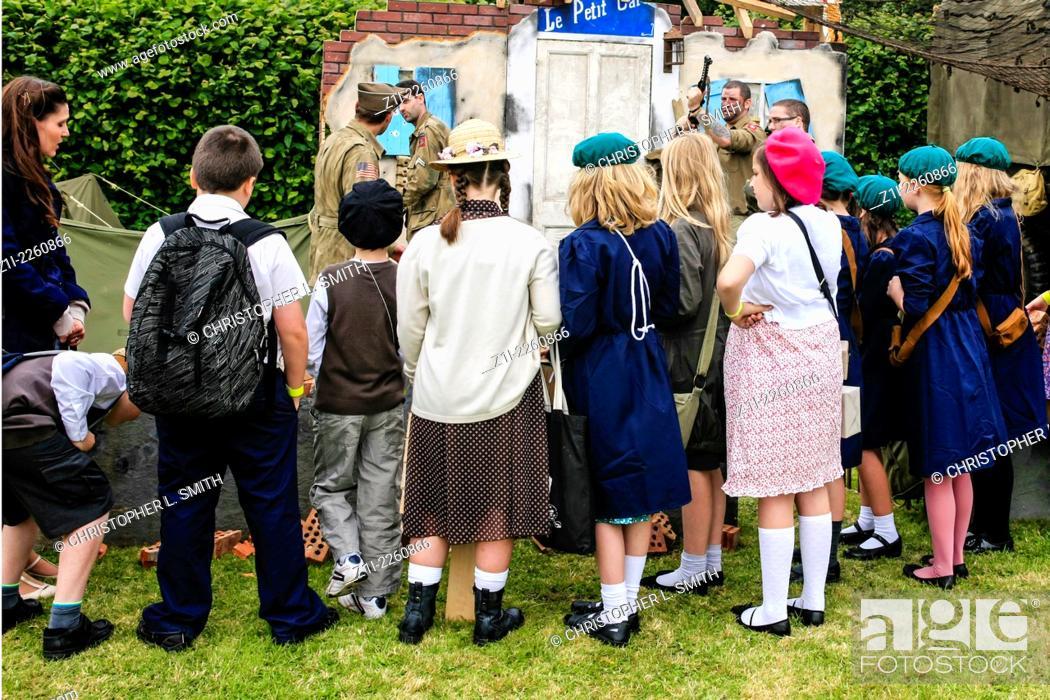 Children dressed in WW2 clothing reenacting those choldren