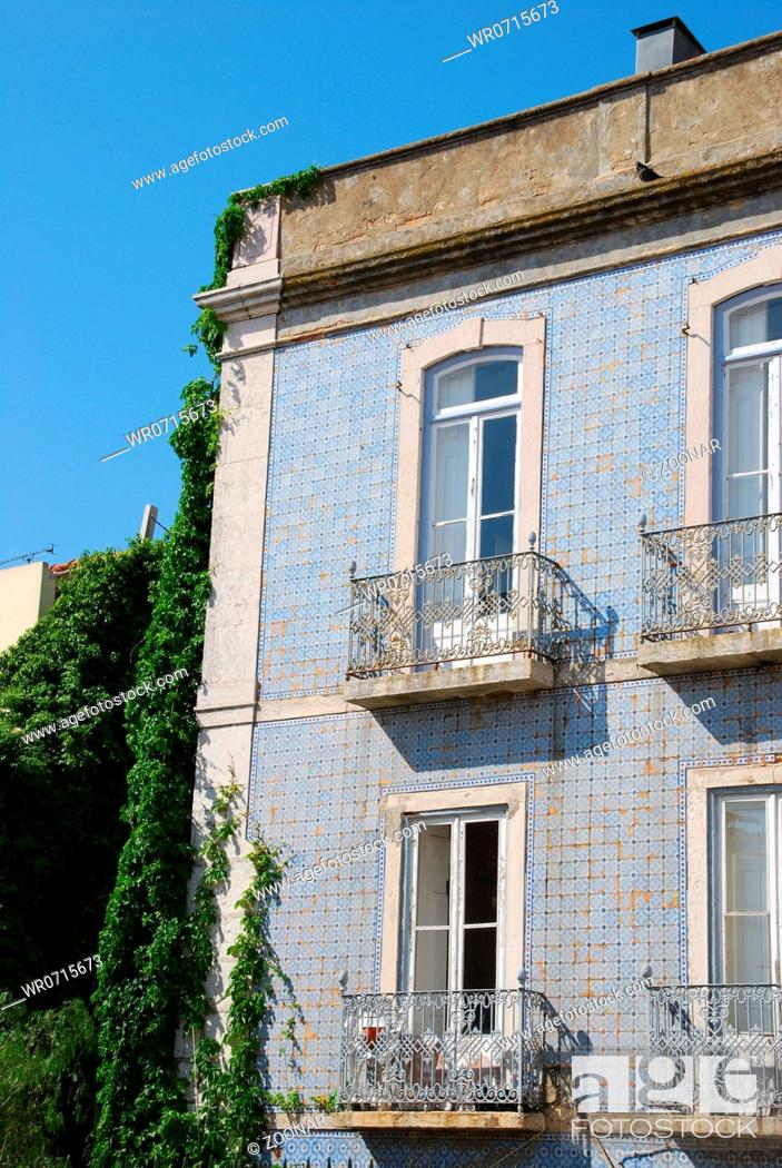 Stock Photo: beautiful and traditional view of antique building with clinging flowers in Lisbon.