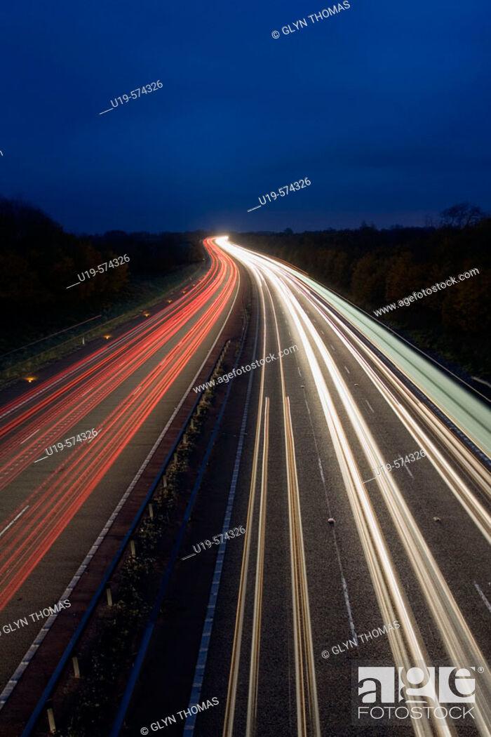 Stock Photo: Traffic trails on the M40 motorway in Warwickshire, England, UK.