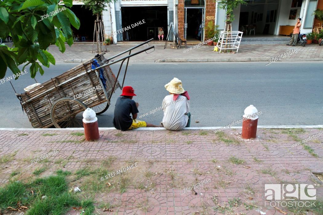 Stock Photo: Women on the Sidewalk in Phnom Penh, Cambodia.