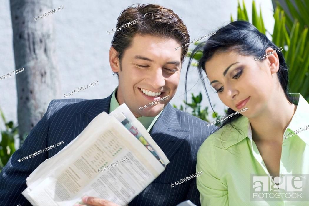 Stock Photo: Close-up of a businessman with a businesswoman and smiling.