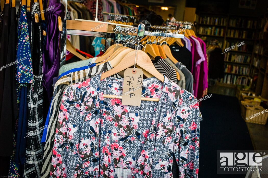 Stock Photo: A Fat Face label adorns an extra small item in a charity thrift shop, Bath, England.