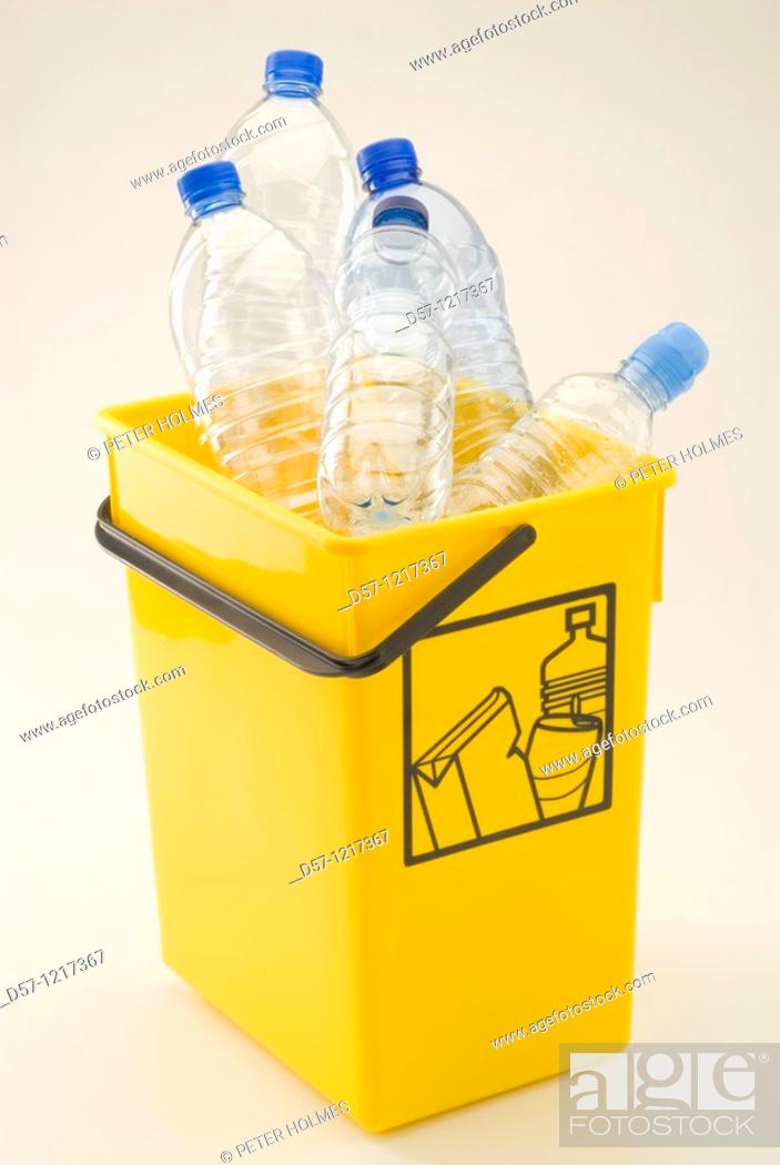 Stock Photo: Yellow recycling bin for plastic and aluminum.
