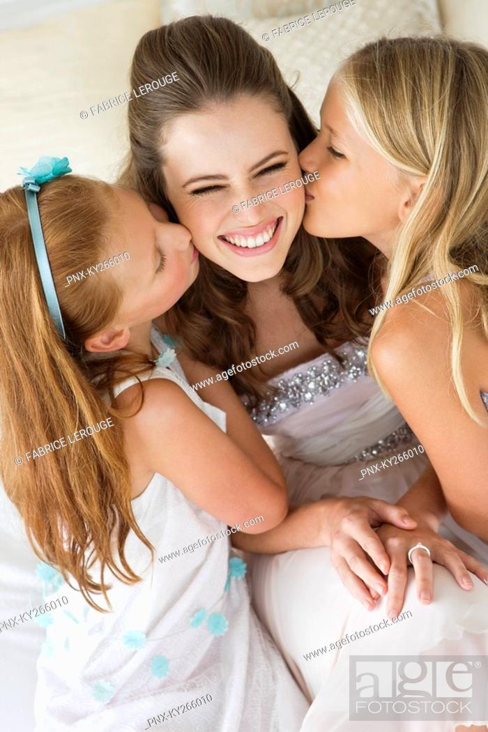 Stock Photo: Two girls kissing a bride.