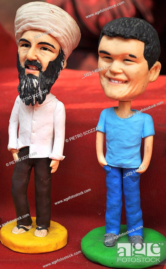 Stock Photo: Shanghai (China): handmade statuettes of Osama Bin Laden and Yao Ming sold at the Yuyuan Bazaar, in the Old Town.