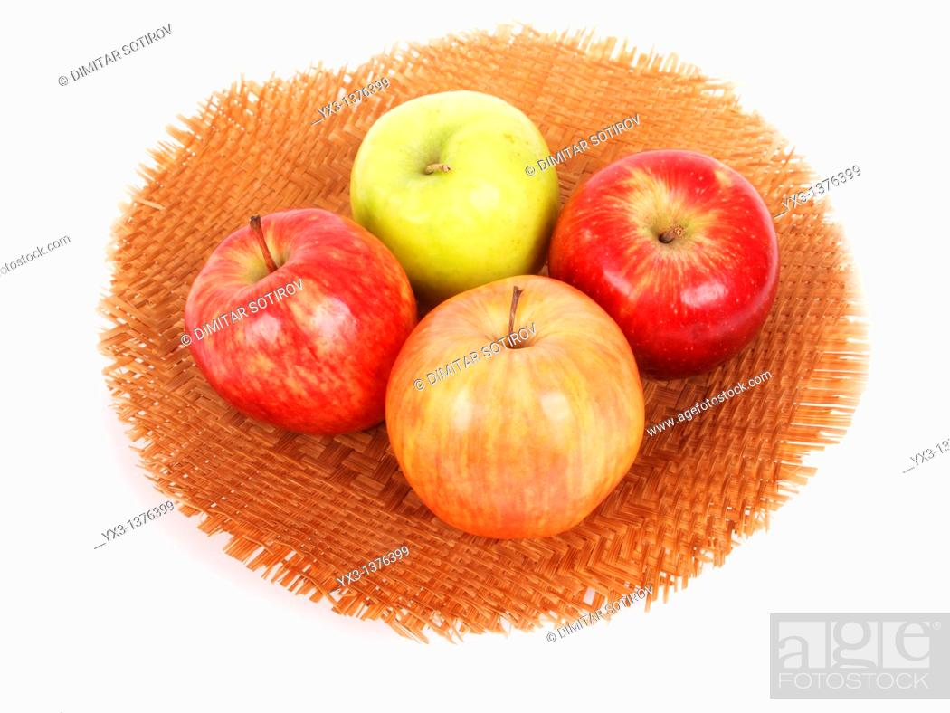 Stock Photo: Apples in a basket isolated on white.
