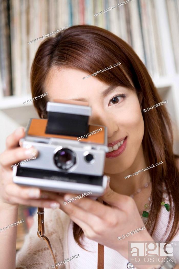 Stock Photo: Woman who takes a photograph.