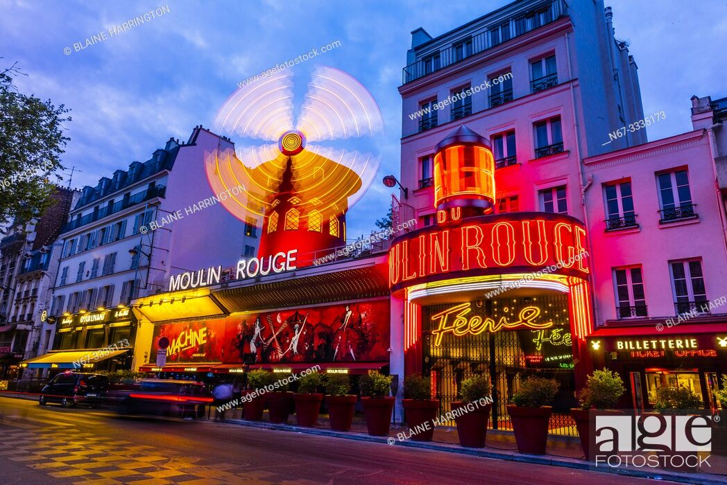 Stock Photo: Moulin Rouge (French for Red Windmill) is a tourist attraction in Pigalle on Boulevard de Clichy, 18th arrondissement. It is best known as the birthplace of the.