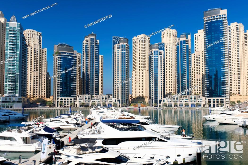 Stock Photo: View of high-rise modern building towers and yachts in Marina at New Dubai in United Arab Emirates.