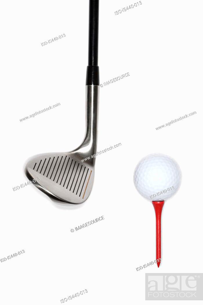 Stock Photo: Golf club with golf ball on a tee.