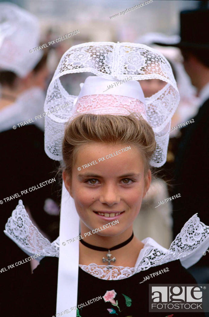 Stock Photo: Breton Traditional Dress / Girl wearing Lace Headdress (Coiffes), Brittany, France.