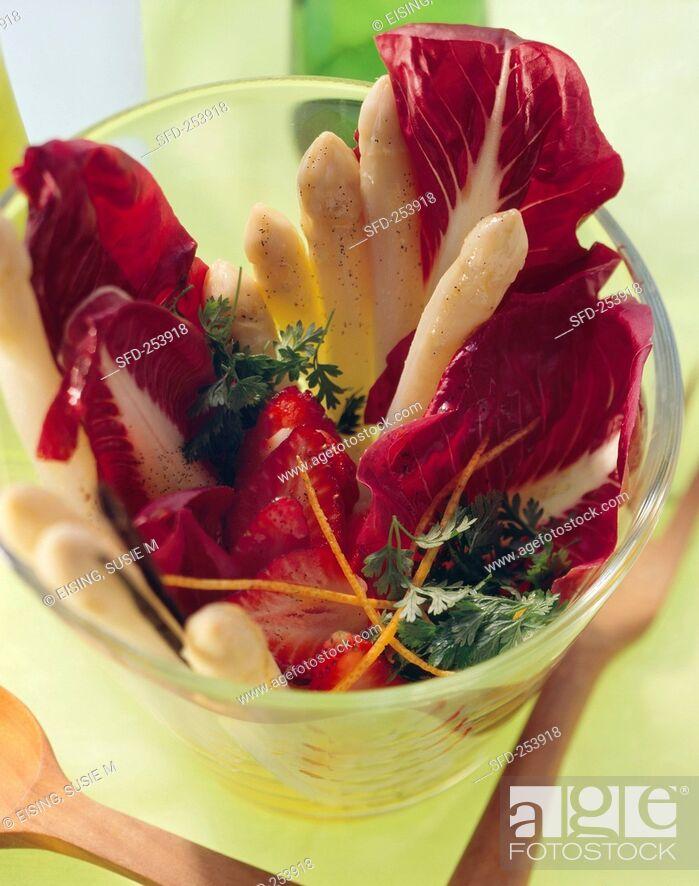 Stock Photo: Asparagus salad with radicchio, strawberries, vanilla oil.