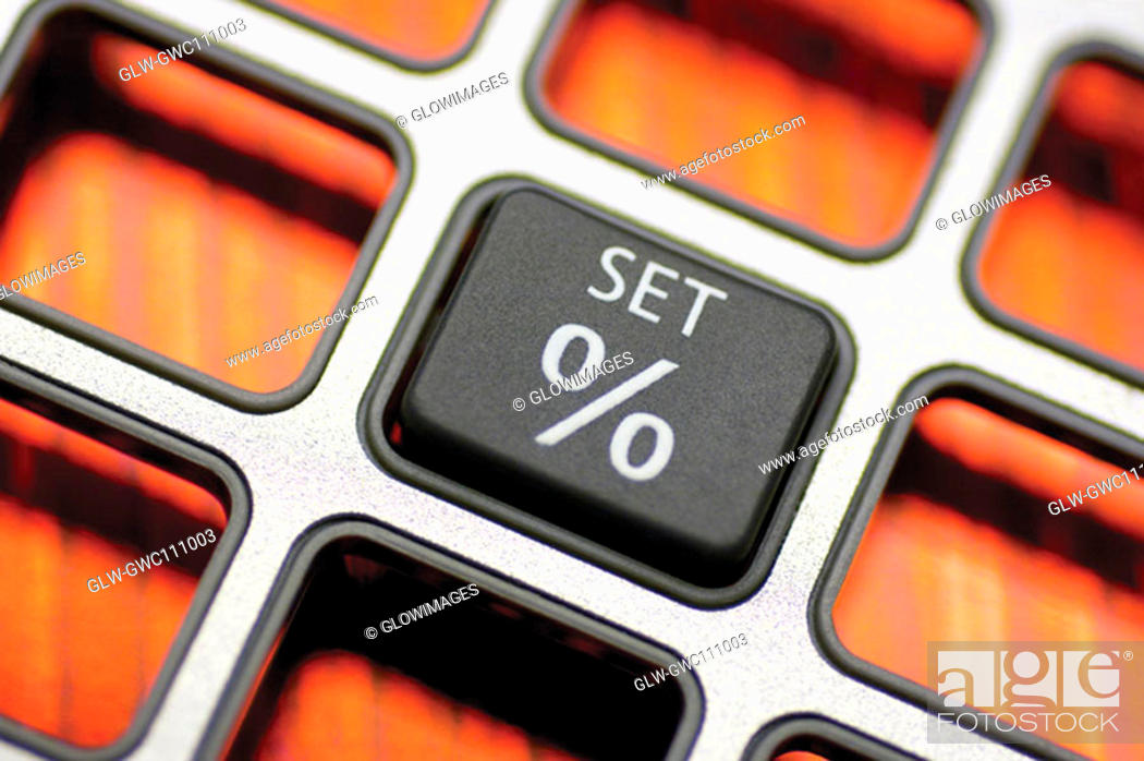 Stock Photo: Close-up of a push button of a calculator.