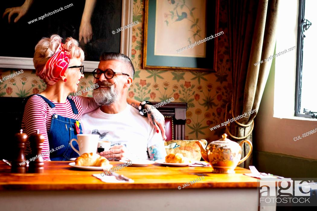 Stock Photo: Quirky couple relaxing in bar and restaurant, Bournemouth, England.