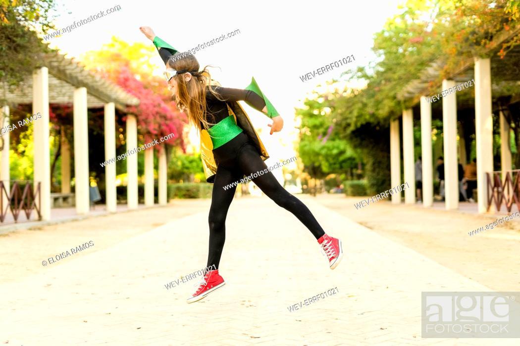 Stock Photo: Girl in super heroine costume jumping.