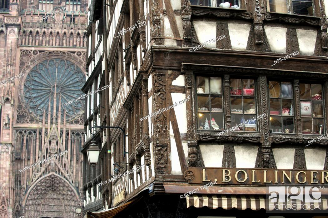 Stock Photo: Strasbourg, frame house beside gothic cathedral, Alsace, France.