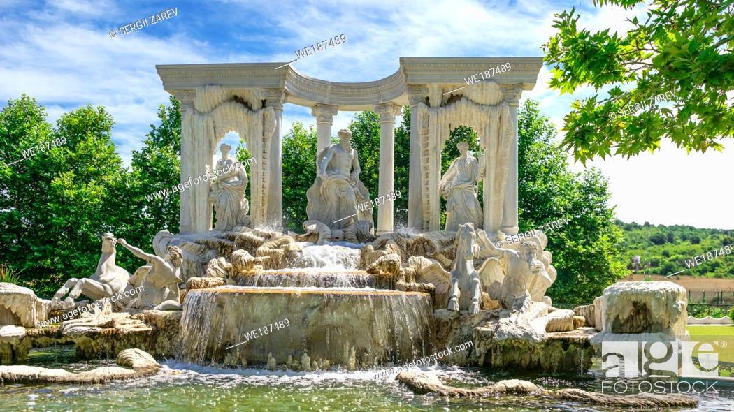 "Stock Photo: Ravadinovo, Bulgaria â. "" 07. 11. 2019. Large antique fountain in the form of a sculptural composition in the castle of Ravadinovo, Bulgaria."
