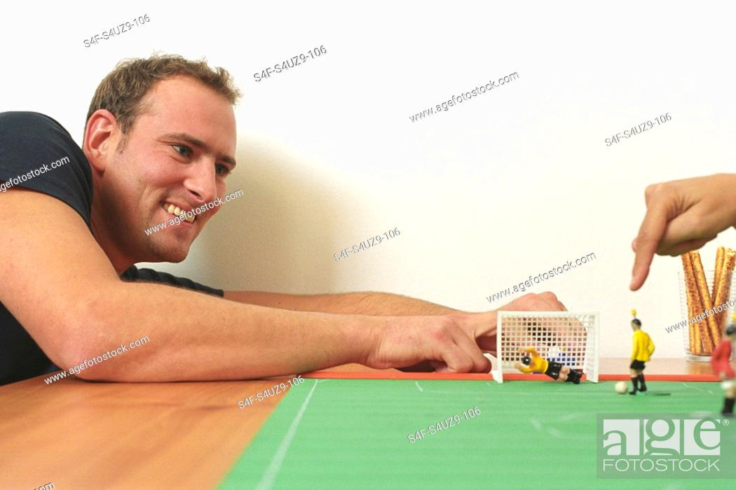 Stock Photo: Man playing with a Table Soccer Game Detail.