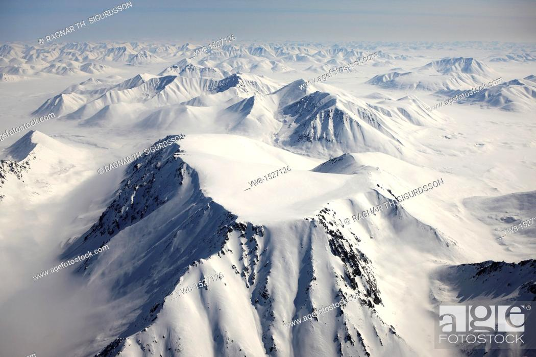 Stock Photo: Mountains Around Chukotka Aerial of snow covered mountains between Egvekinot and Anadyr, Sibera, Russsia.