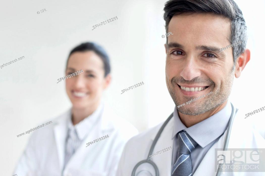 Stock Photo: Male doctor with female colleague.