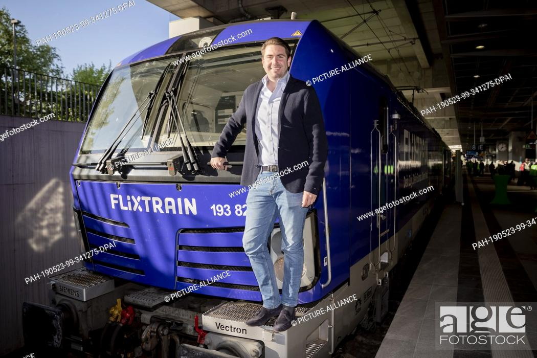 Stock Photo: 23 May 2019, North Rhine-Westphalia, Cologne: Fabian Stenger, Managing Director of FlixTrain, is about to depart from the first FlixTrain connection between.