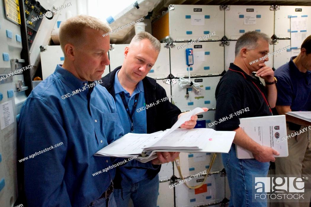 Stock Photo: Astronauts Tim Kopra (left), STS-127 mission specialist; Doug Hurley, pilot; Dave Wolf and Tom Marshburn (partially out of frame), both mission specialists.