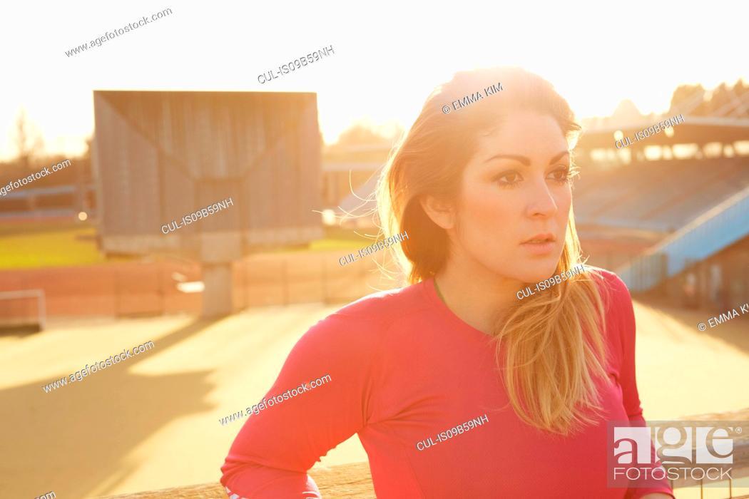 Photo de stock: Female runner taking a break in park.
