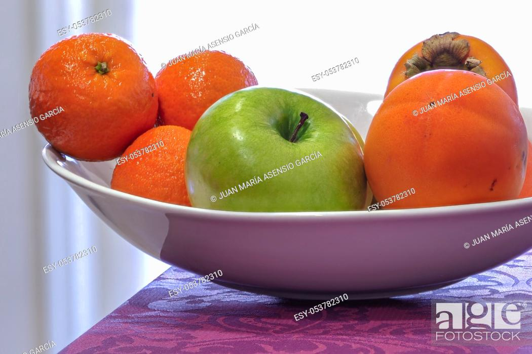 Stock Photo: fruit bowl with orange and apple.