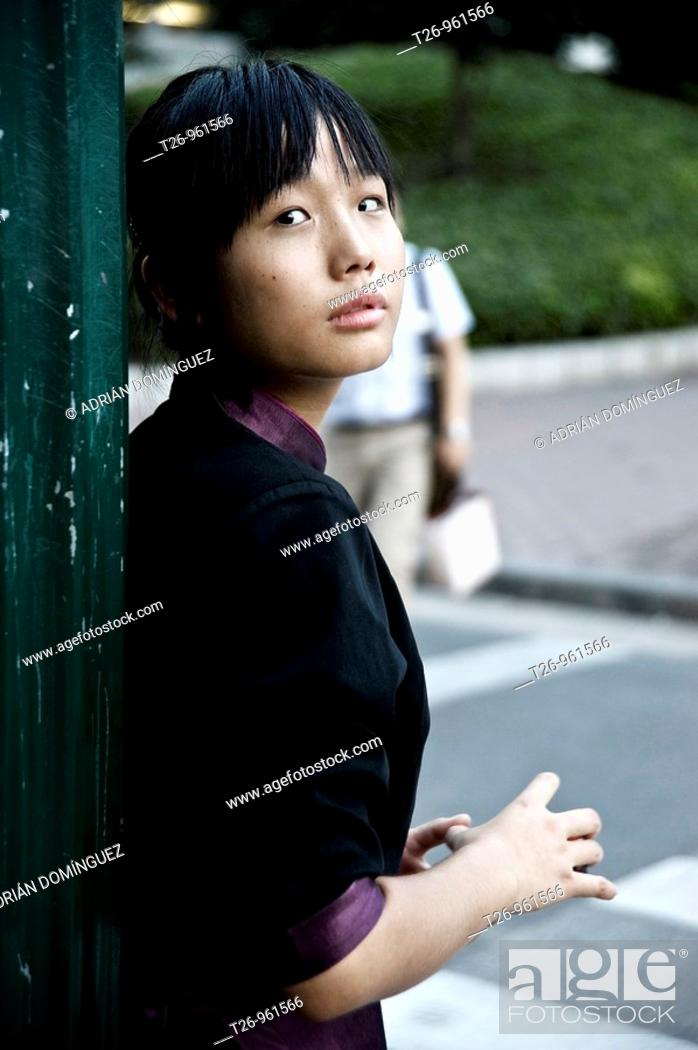 Stock Photo: A woman looks at the camera. Shanghai, China.