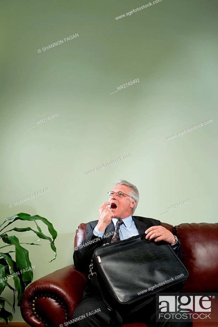 Stock Photo: Man using breath freshener.