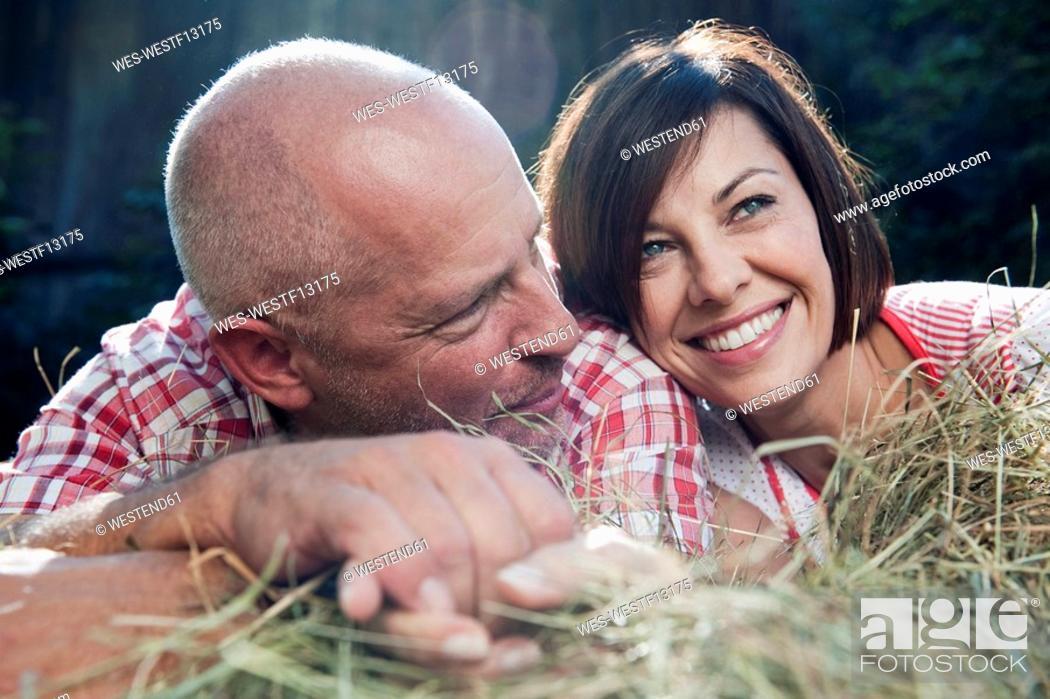 Stock Photo: Germany, Bavaria, Couple lying on haystack.
