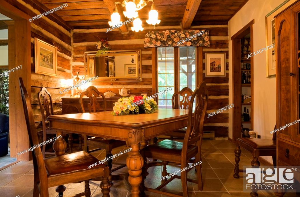Old wooden dining table and chairs in dining room inside a ...