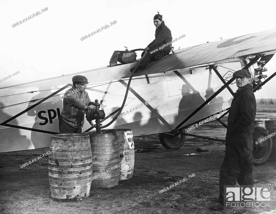 Stock Photo: Roosevelt Field, New York: December 22, 1927.Mechanics pumping 500 gallons of fuel into the Fokker monoplane Splitdorf which Bert Acosta and Emile Burgin will.
