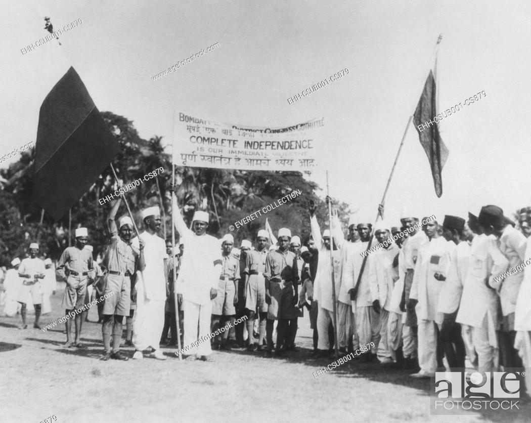 Stock Photo: 'Satyagrahi' volunteers in Bombay (Mumbai) salute the National Congress flag. India, May 1930. The term 'satyagraha' was developed by Mahatma Gandhi.