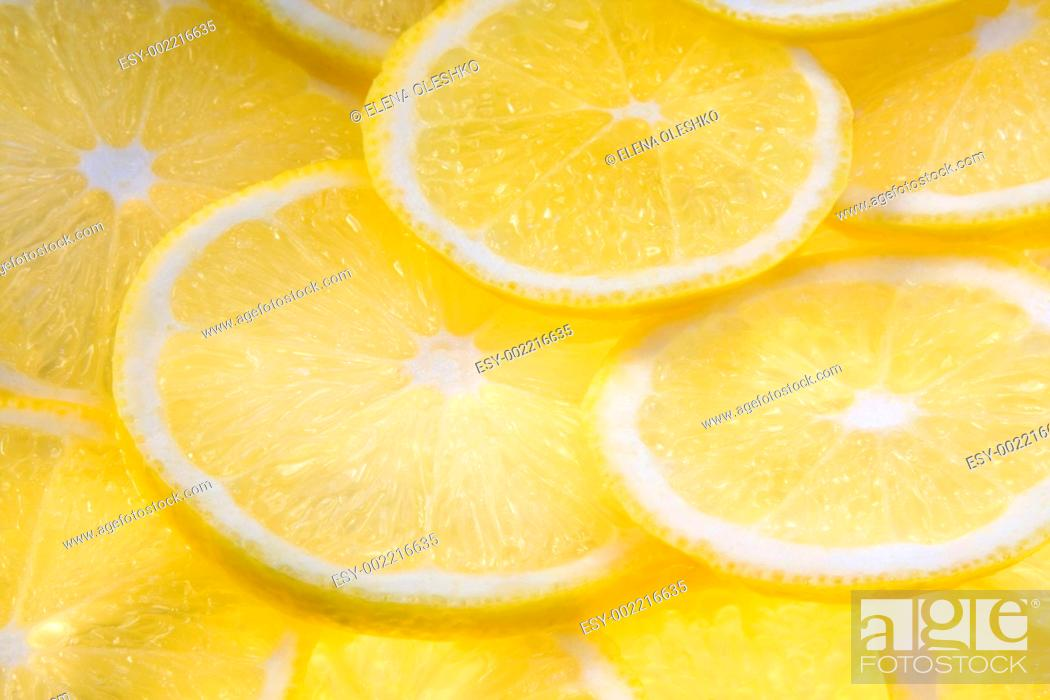 Stock Photo: Background with lemon slices illuminated from below.