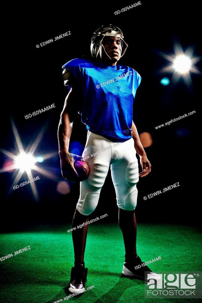 Stock Photo: Full length portrait of american football player.