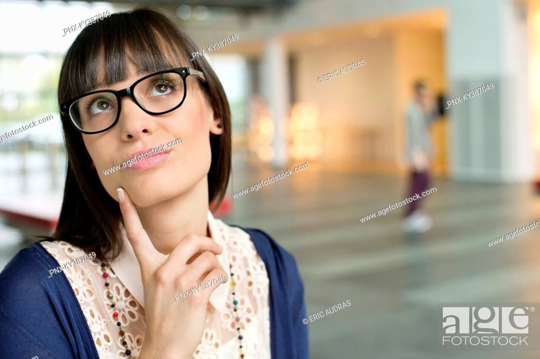 Stock Photo: Close-up of a businesswoman day dreaming.
