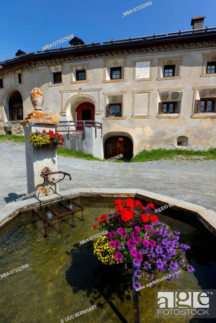 Stock Photo: Townscape with fountain and typical house, Guarda, municipality Scuol, Lower Engadine, Grisons, Switzerland.